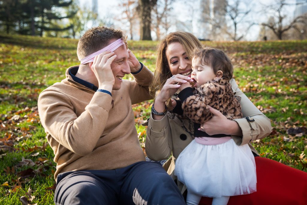 Father wearing little girl's headband for an article on Central Park holiday portrait tips