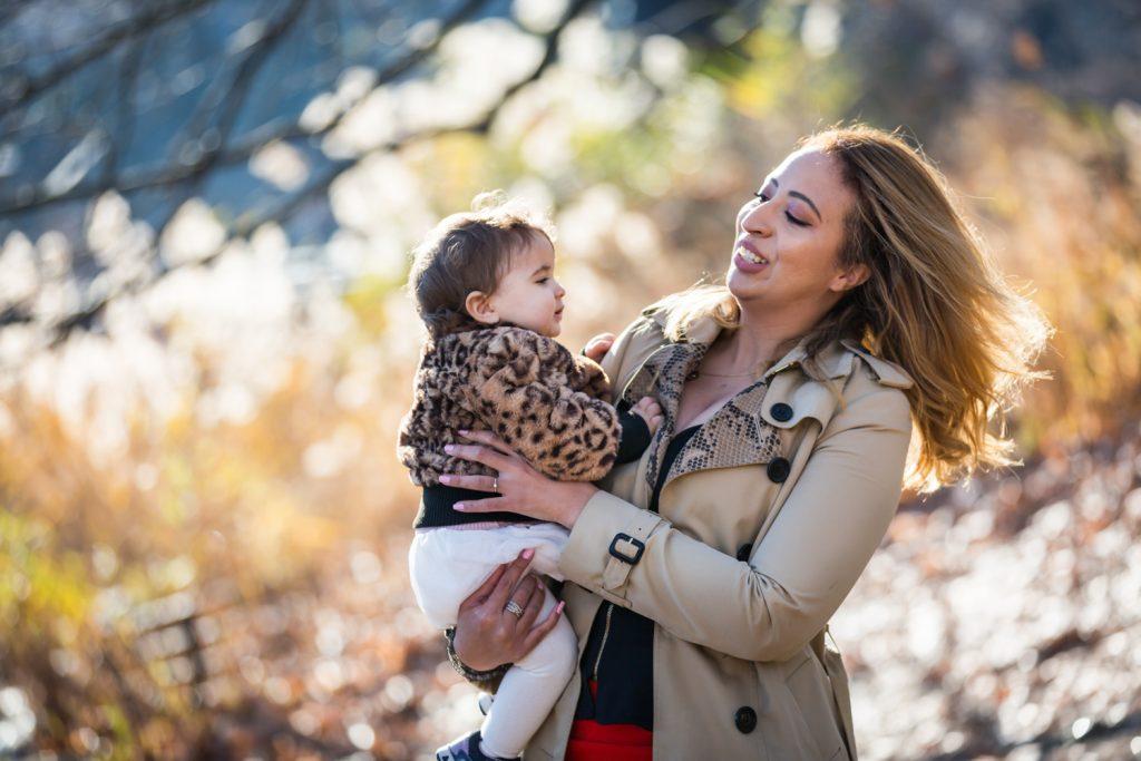 Mother holding little girl in Central Park