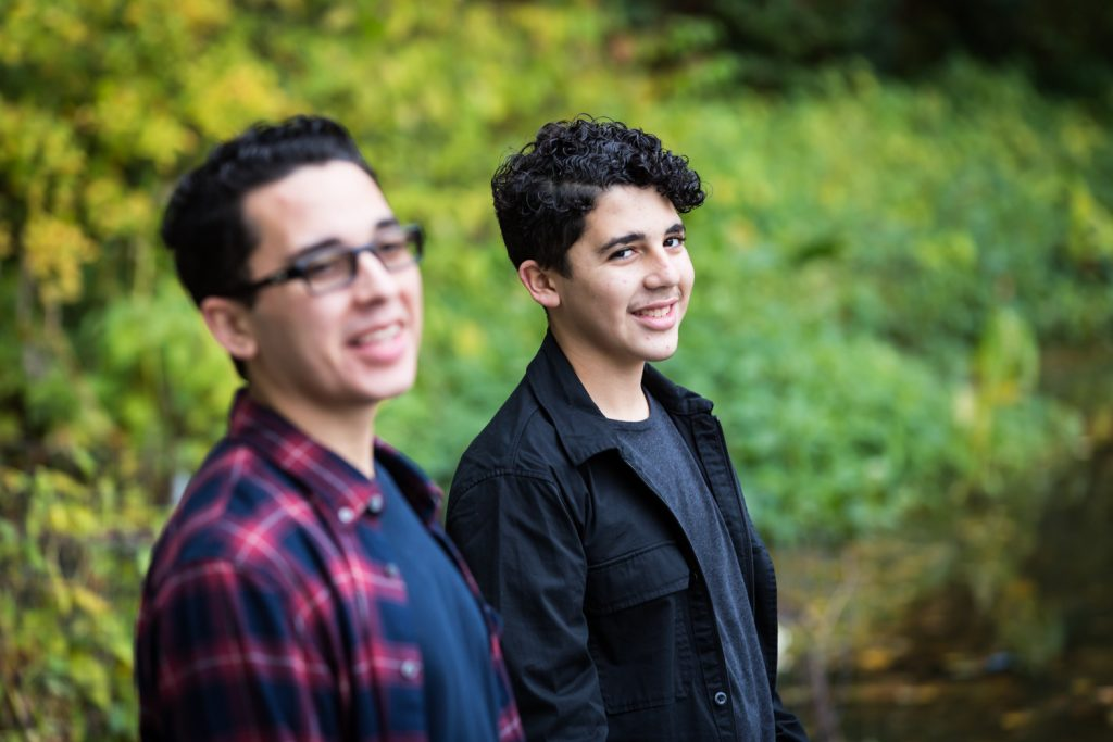 Two young men in front of Turtle Pond in Central Park