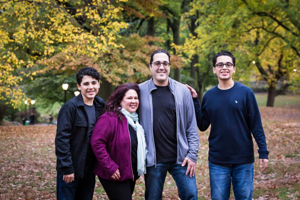 Family in forest during a Central Park senior portrait session