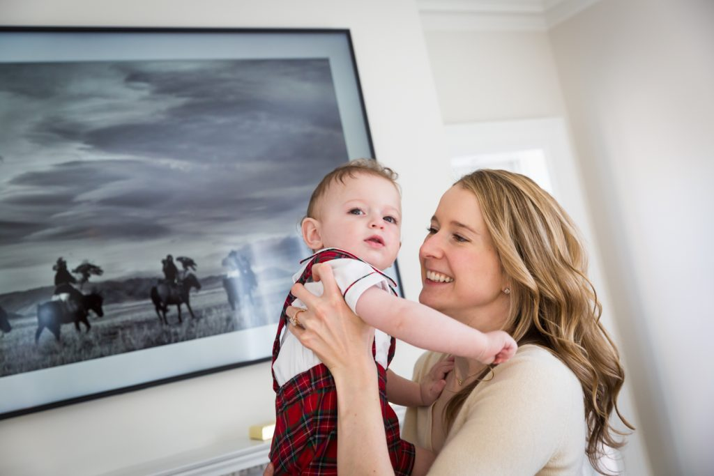 Mother holding baby boy for an article on holiday family portrait ideas