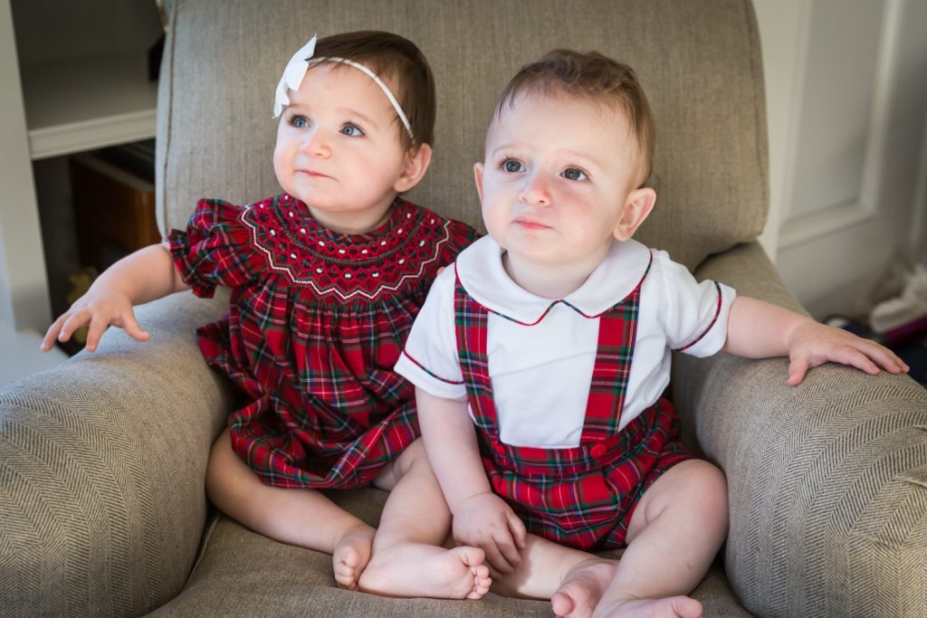 Twin babies sitting in a chair
