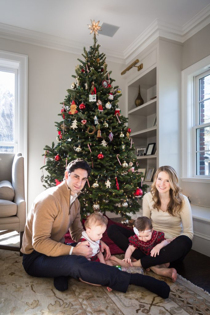 Parents with twin babies in front of Christmas tree