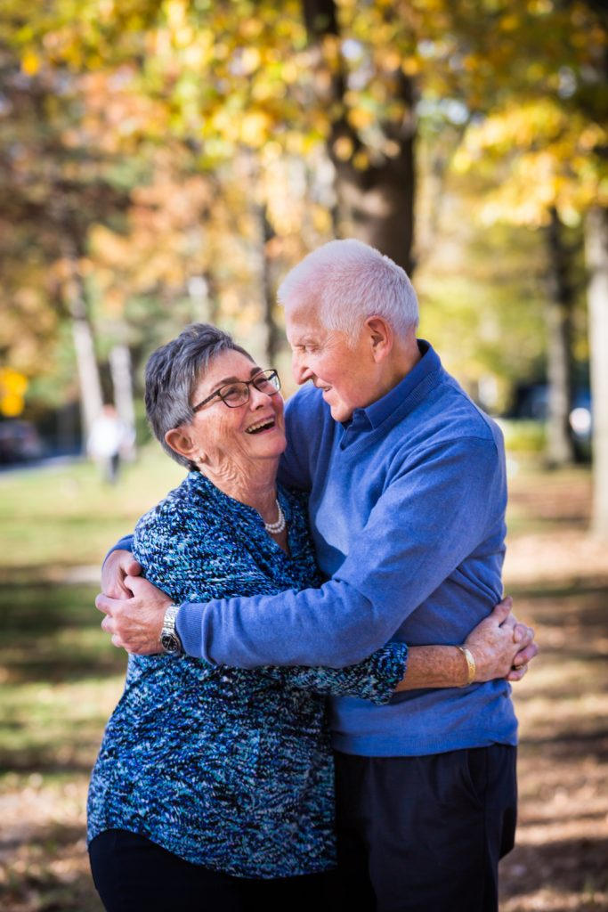 Older couple hugging during a Juniper Valley Park family portrait session