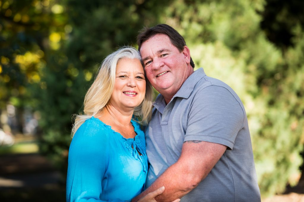 Couple hugging during a Juniper Valley Park family portrait session