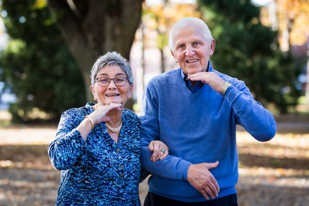 Older couple with hands under chins
