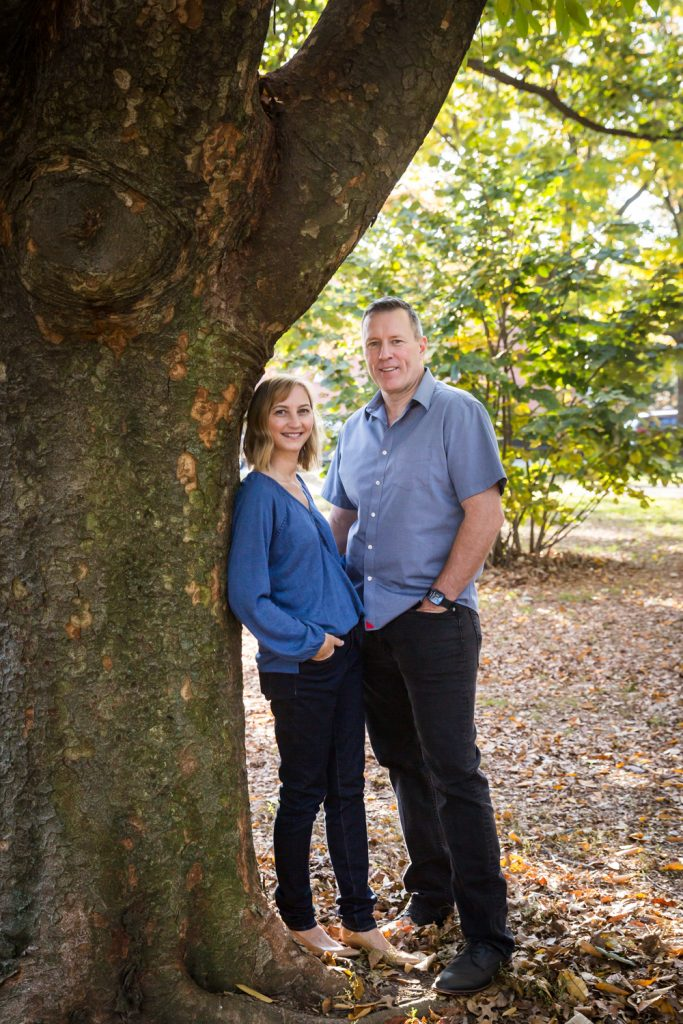 Couple leaning against tree in Juniper Valley Park