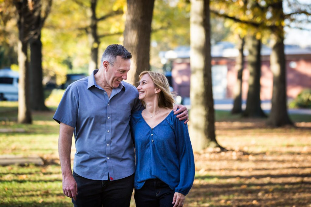 Couple walking in park during a Juniper Valley Park family portrait session