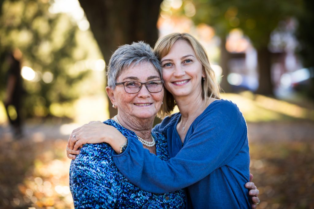 Mother and daughter hugging during Juniper Valley Park family portrait session