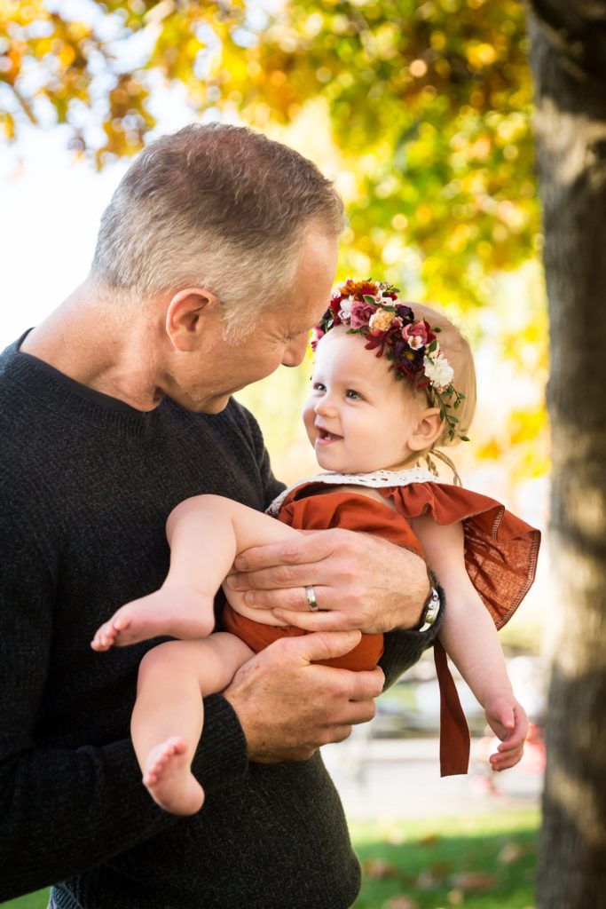Father holding little girl for an article NYC golden hour portrait tips