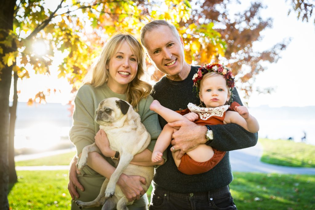Parents with little girl and dog for an article NYC golden hour portrait tips
