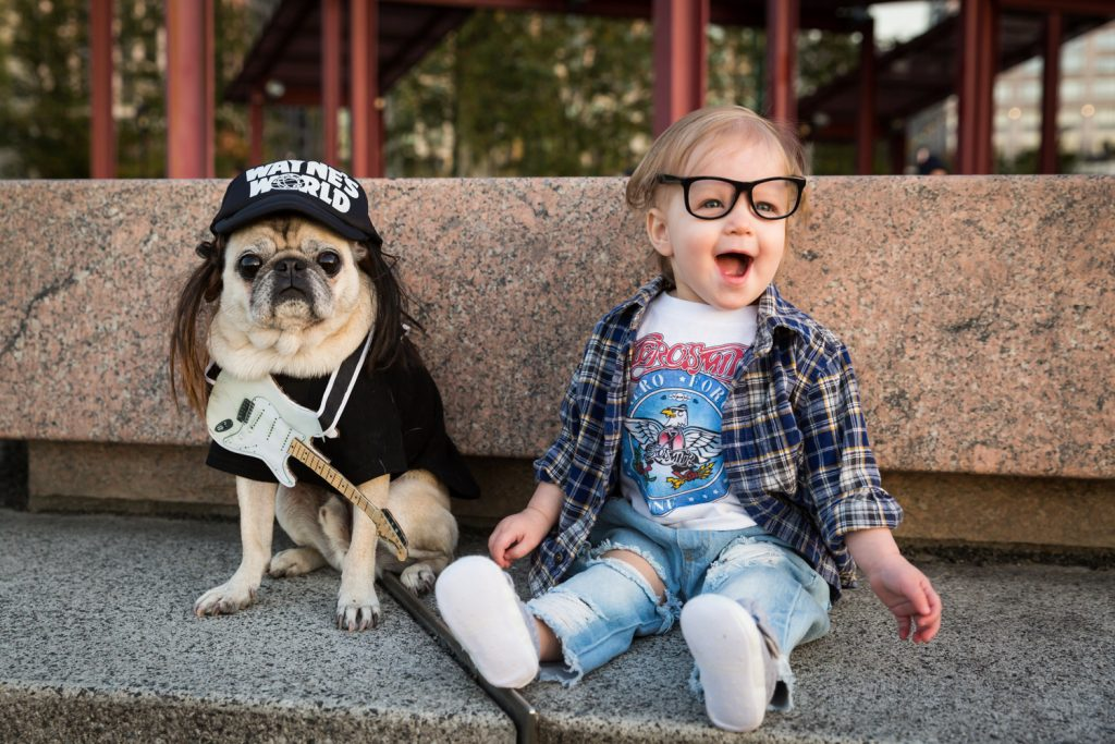 Little girl and dog dressed in Wayne's World Halloween costume