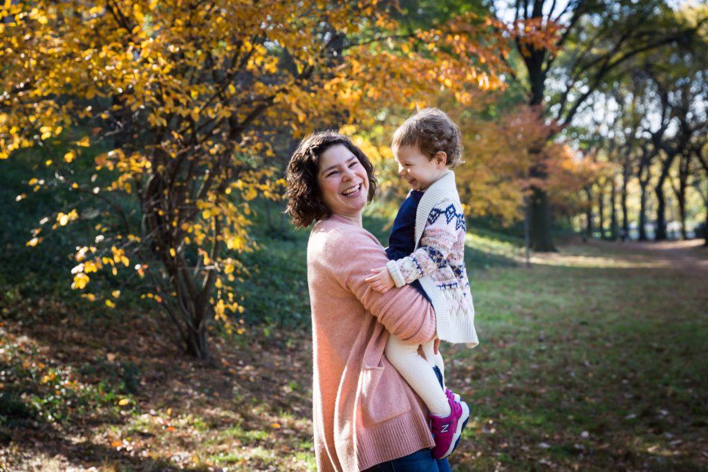 Mother holding little girl in Riverside Park