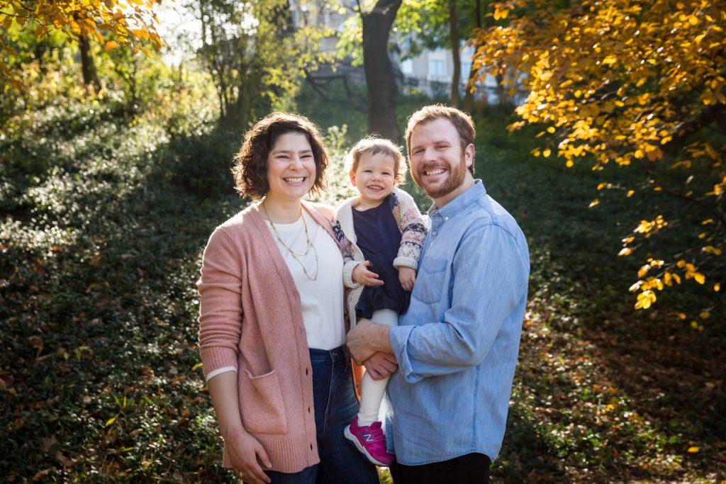 Parents holding little girl in Riverside Park