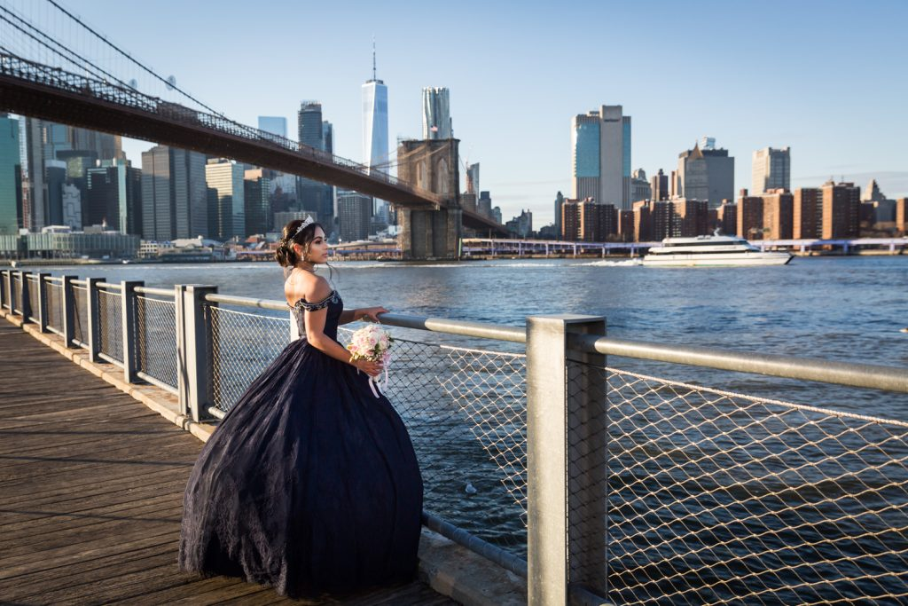 Girl wearing navy ball gown looking at East River