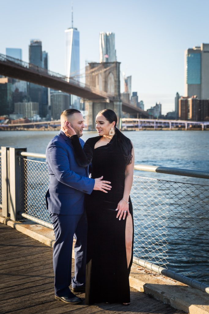 Couple on Brooklyn Bridge Park boardwalk looking at each other