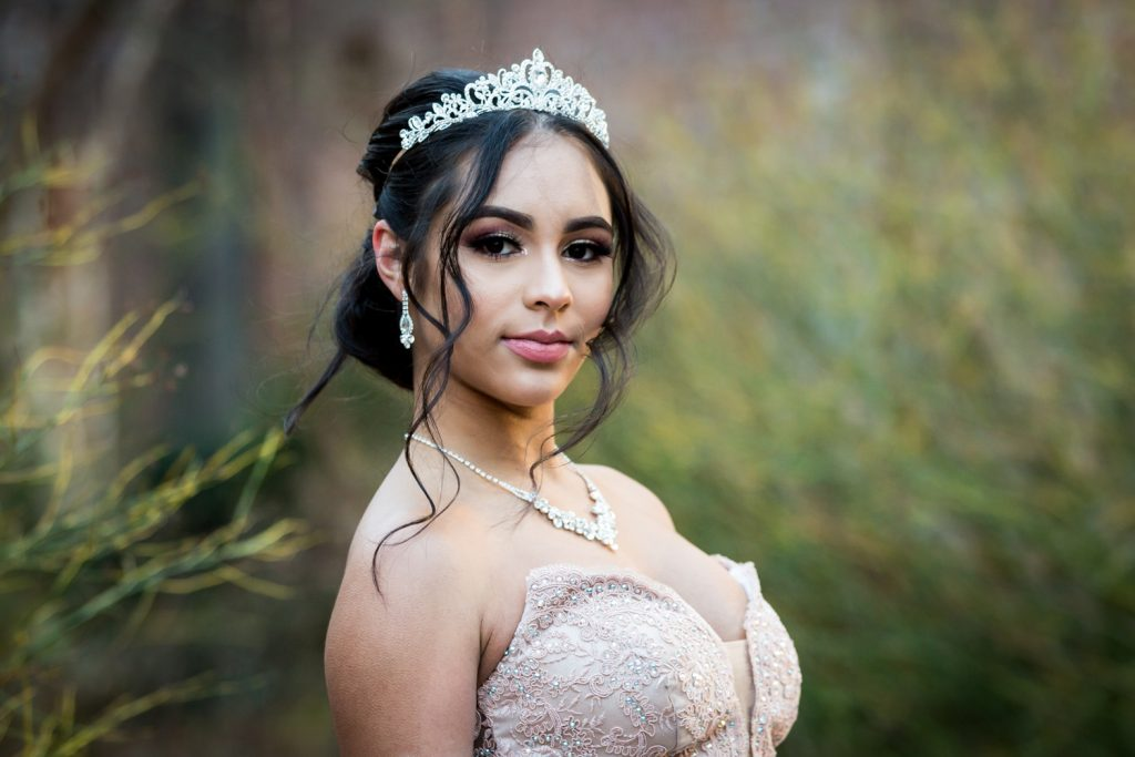 Girl wearing tiara with long tendrils Girl wearing tiara and coat with fur hood for an article on cold weather portrait tips